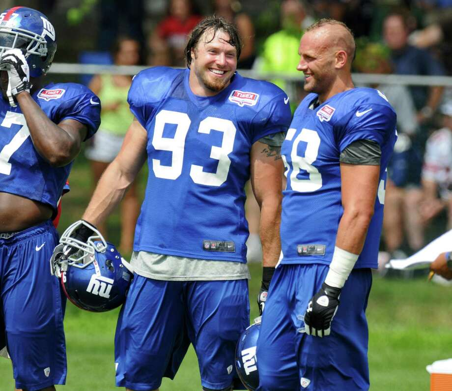 New York Giants linebackers Chase Blackburn, left, and Mark Herzlich, right, on the sidelines during  a training camp practice at UAlbany on Monday July 30, 2012 in Albany, NY.  (Philip Kamrass / Times Union) Photo: Philip Kamrass / 00018618A