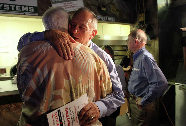 Texas Senator Jeff Wentworth hugs a supporter after addressing an audience at Chester's Hamburgers after getting results from the District 25 runoff election on Tuesday, July 31, 2012. Wentworth lost the race to Dr. Donna Campbell. Wentworth, 71, served in the Texas House since 1988. He has been a state senator since 1993. Photo: Kin Man Hui, SAN ANTONIO EXPRESS-NEWS / ©2012 San Antonio Express-News