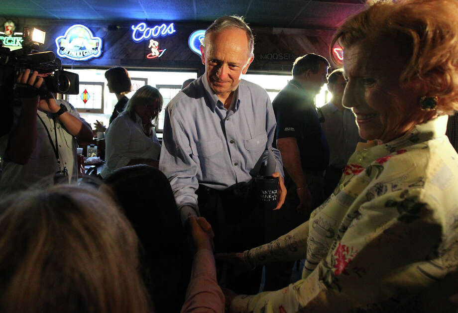 Texas Senator Jeff Wentworth shakes hands with supporters at Chester's Hamburgers while awaiting results from the District 25 runoff election on Tuesday, July 31, 2012. Wentworth lost the race to Dr. Donna Campbell. Wentworth, 71, served in the Texas House since 1988. He has been a state senator since 1993. Photo: Kin Man Hui, SAN ANTONIO EXPRESS-NEWS / ©2012 San Antonio Express-News