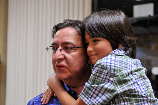 Democratic Congressional candidate Pete Gallego gets hugged by his son Nicholas at his campaign headquarters Tuesday night. Photo: Robin Jerstad