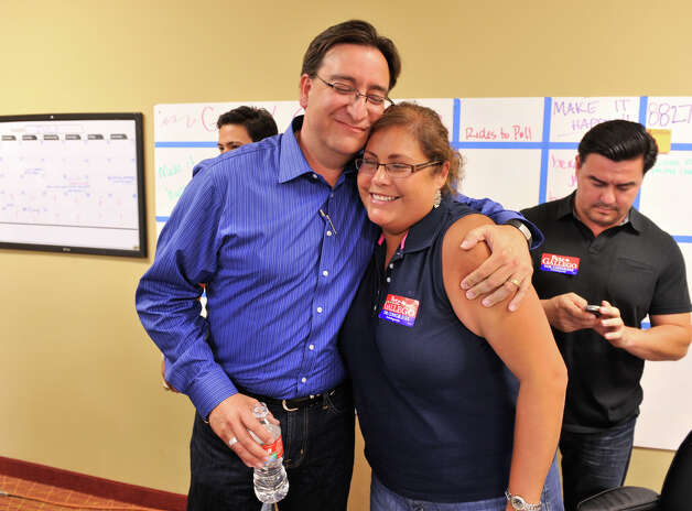 Democratic Congressional candidate Pete Gallego gets a hug from former city council person Jennifer Ramos. Photo: Robin Jerstad