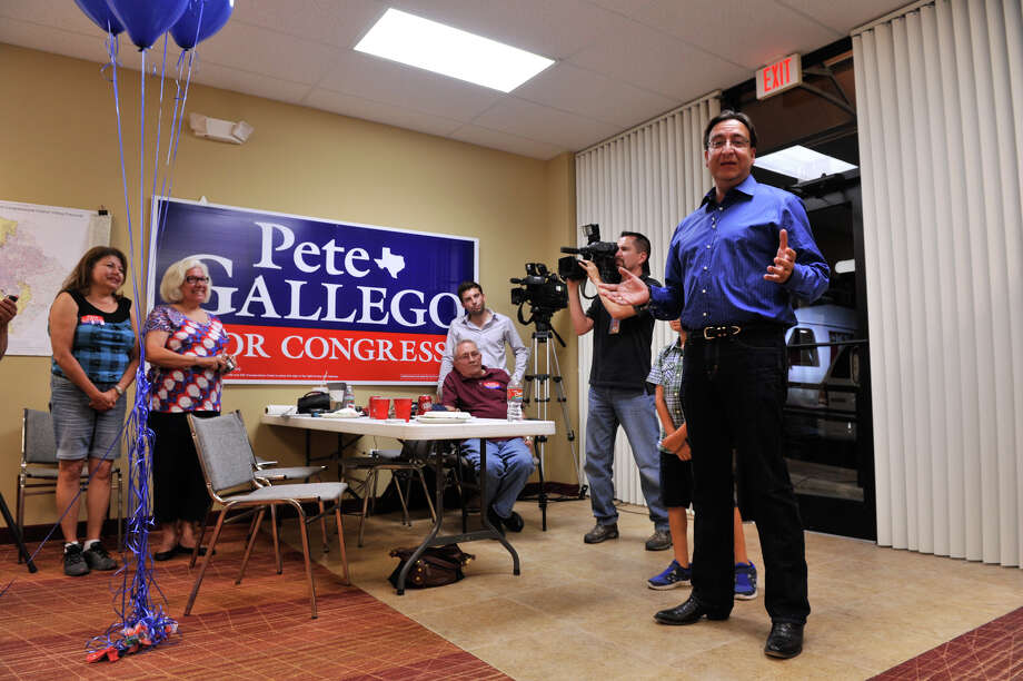 SLUG; us house dist 23-AssignID 442867-July 31, 2012-San Antonio, Texas---Democratic Congressional candidate Pete Gallego greets well-wishers at his campaign headquarters Tuesday evening. Photo: Robin Jerstad