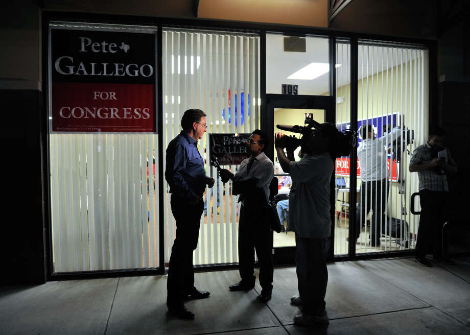 Democratic Congressional candidate Pete Gallego speaks to the media outside his campaign headquarters Tuesday evening. Photo: Robin Jerstad