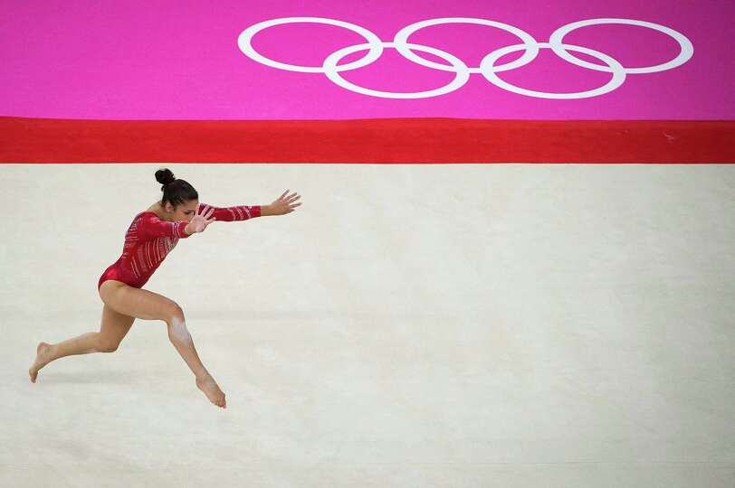 U.S. gymnast Aly Raisman performs on the floor exercise during the women's gymnastics team finals at