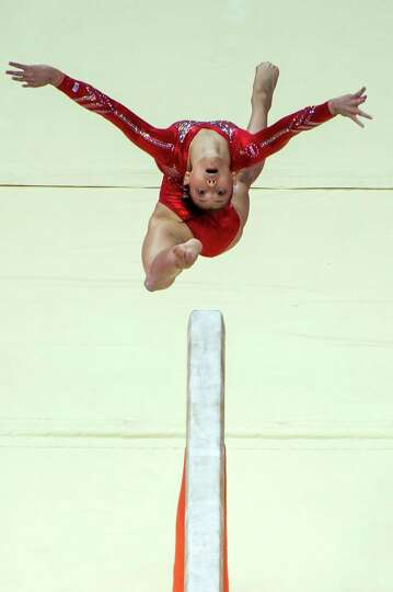 U.S. gymnast Kyla Ross performs on the balance beam during the women's gymnastics team finals at the