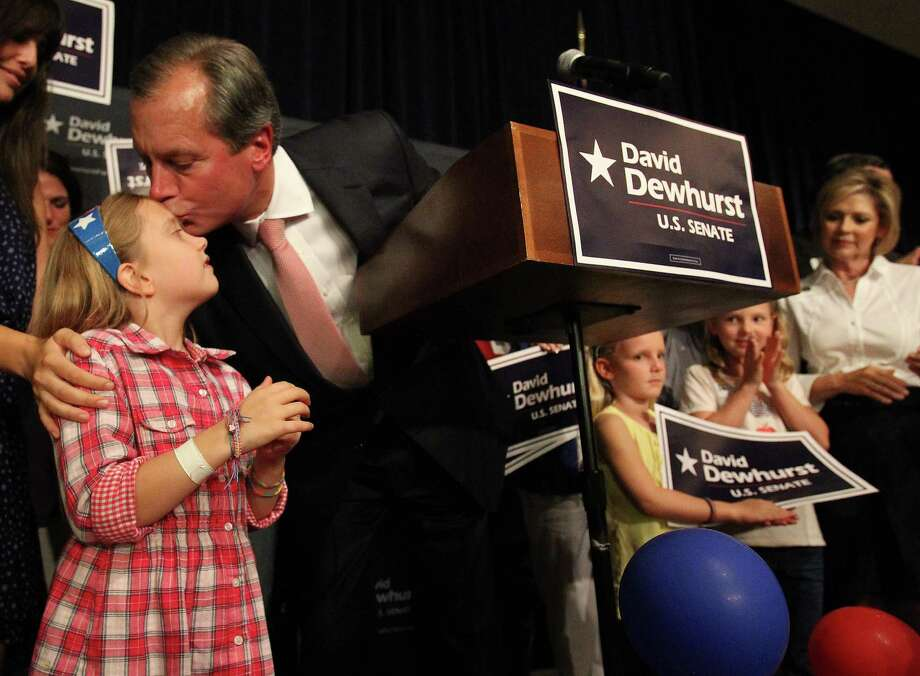 GOP Senate candidate David Dewhurst gives his daughter Carolyn, 8, a kiss after his concession speech on the stage during the election watch party for him at the Houston Omni,  Tuesday, July 31, 2012, in Houston. Photo: Karen Warren, Houston Chronicle / © 2012  Houston Chronicle
