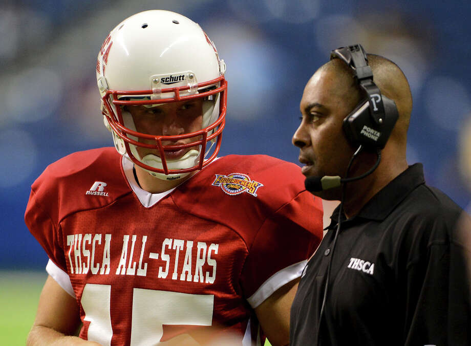 South head coach Mike Jinks (right) talks to Warren quarterback Rex Dausin (left) during the 2012 Texas high school coaches association all-star football game on July 31, 2012 in the Alamodome in San Antonio Texas.