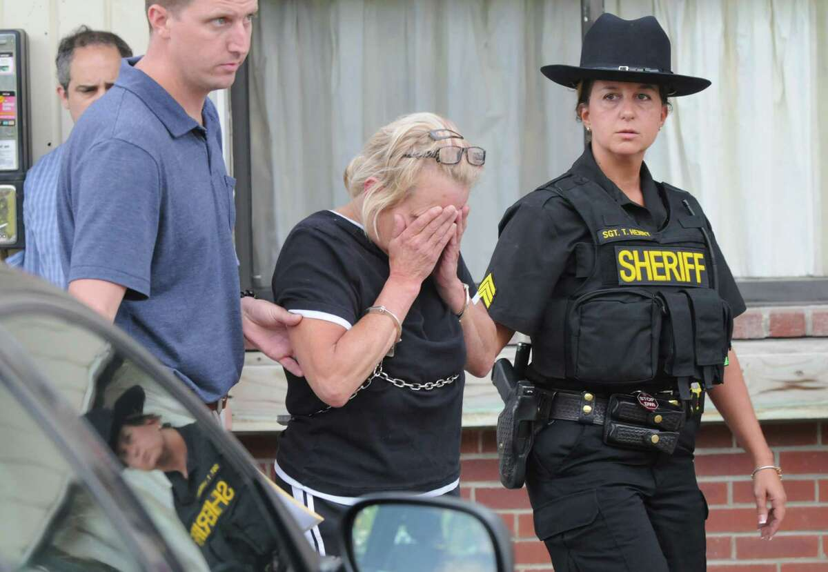 Tracey Zetzsche, 52, is escorted out of Westerlo Town Hall following her court appearance Tuesday evening July 31, 2012 in Westerlo, N.Y. Zetzsche was arrested Tuesday afternoon on a charge of second-degree murder. She is accused of killing her son, Gabriel Philby-Zetzsche, who died of blunt-force and stabbing wounds. (Will Waldron / Times Union)
