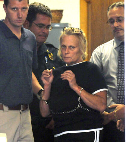 Tracey Zetzsche, 52, is escorted out of Westerlo Town Hall following her court appearance Tuesday evening July 31, 2012, in Westerlo, N.Y. Zetzsche was arrested Tuesday afternoon on a charge of second-degree murder. She is accused of killing her son, Gabriel Philby-Zetzsche, who died of blunt-force and stabbing wounds. (Will Waldron / Times Union) Photo: Will Waldron