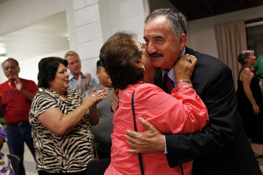 Ciro Rodriguez embraces Jo Ann Ramon as he greets supporters upon his arrival at the Harlandale Civic Center where supporters gathered to watch the results come in from his runoff against Pete Gallego for the Democratic nomination for U.S. House District 23 in San Antonio on Tuesday, July 31, 2012. Photo: Lisa Krantz, San Antonio Express-News / San Antonio Express-News