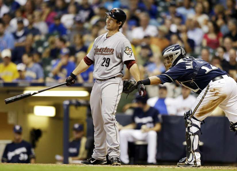 Astros' Brett Wallace strikes out and is tagged by Brewers catcher Martin Maldonado. (JEFFREY PHELPS