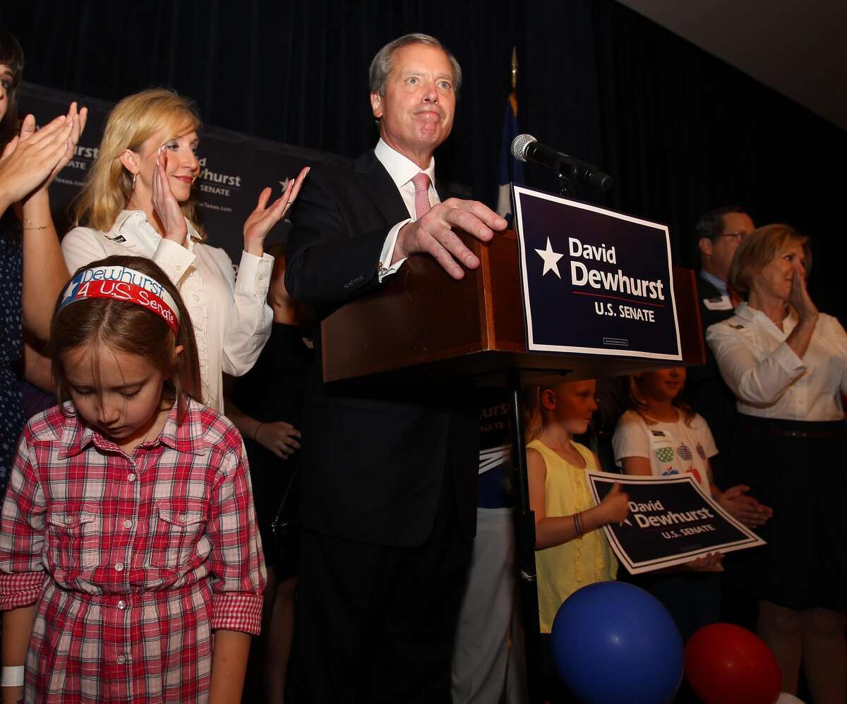 David Dewhurst gives his concession speech with his wife, Tricia, and his daughter Carolyn, 8, at his side at the Houston Omni.