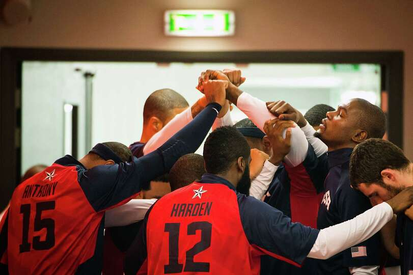 Team USA players huddle before taking the court to face Tunisia during a men's preliminary round bas