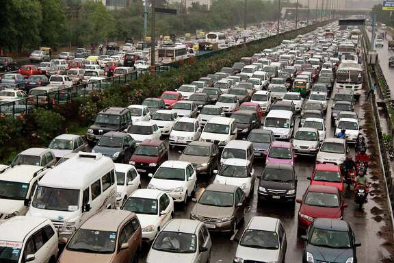 A traffic jam following power outage and rains at the Delhi-Gurgaon road on the outskirts of New Delhi, India, Tuesday, July 31, 2012. India's energy crisis cascaded over half the country Tuesday when three of its regional grids collapsed, leaving 620 million people without government-supplied electricity in one of the world's biggest-ever blackouts.