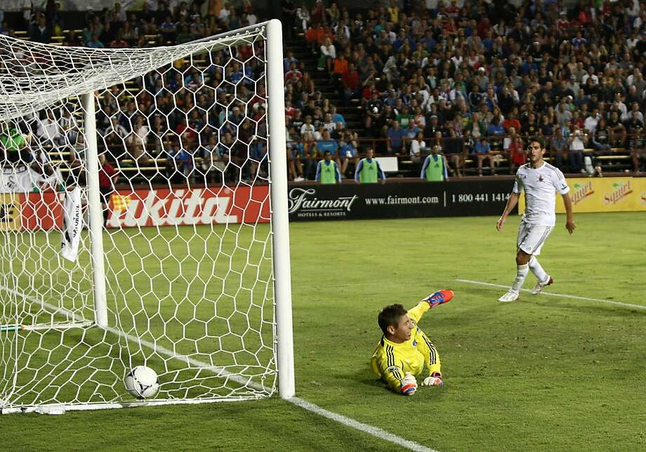 SANTA CLARA, CA - JULY 31:  Goalkeeper David Bingham #43 of the San Jose Earthquakes dives but misses a shot on net by  defender Chico #4 of the Swansea City (Not Pictured) in the 59th minute of the match making the score 2-0 Swansea City durng a game against the San Jose Earthquakes at Buck Shaw Stadium on July 31, 2012 in Santa Clara, California.  (Photo by Tony Medina/Getty Images) Photo: Tony Medina, Getty Images