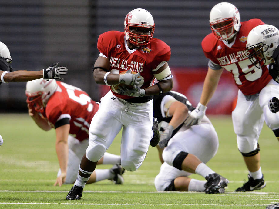 Fort Bend Hightower's Martel Matthews (32) looks for running room during the 2012 Texas high school coaches association all-star football game on July 31, 2012 at the Alamodome. Photo: JOHN ALBRIGHT, John Albright, For The Express-News / San Antonio Express-News