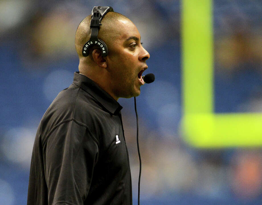South head coach Mike Jinks held to the sideline during the 2012 Texas high school coaches association all-star football game on July 31, 2012 at the Alamodome. Photo: JOHN ALBRIGHT, John Albright, For The Express-News / San Antonio Express-News