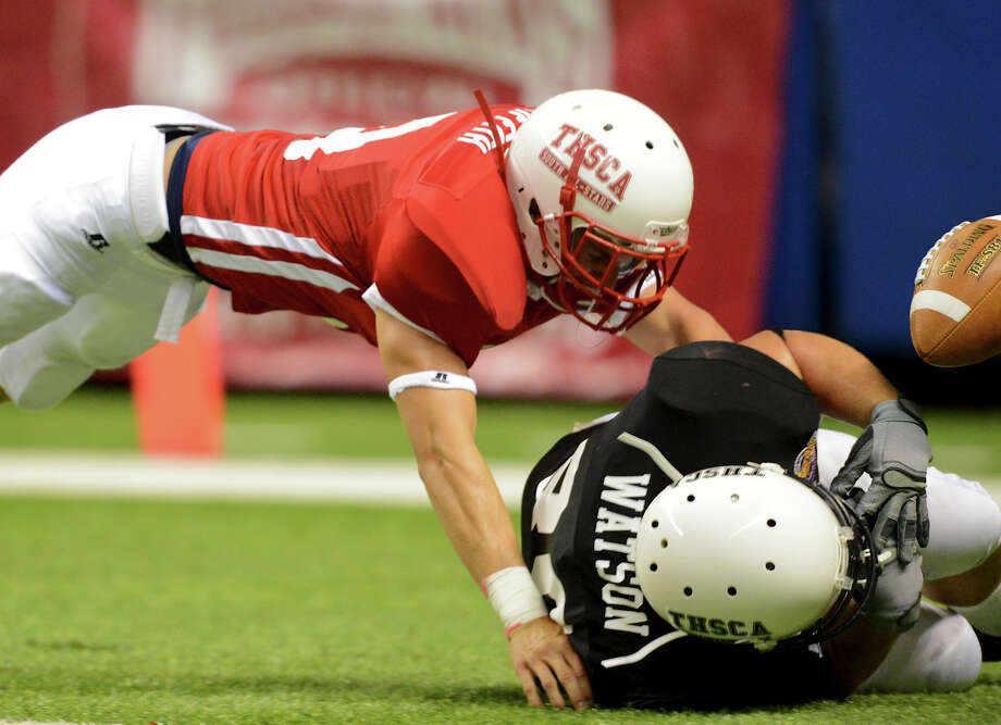 Smithson Valley's Ryan Griffith (left) knocks the ball away from Midland's Dutton Watson (right) in the endzone during the 2012 Texas high school coaches association all-star football game on July 31, 2012 at the Alamodome. Photo: JOHN ALBRIGHT, John Albright, For The Express-News / San Antonio Express-News