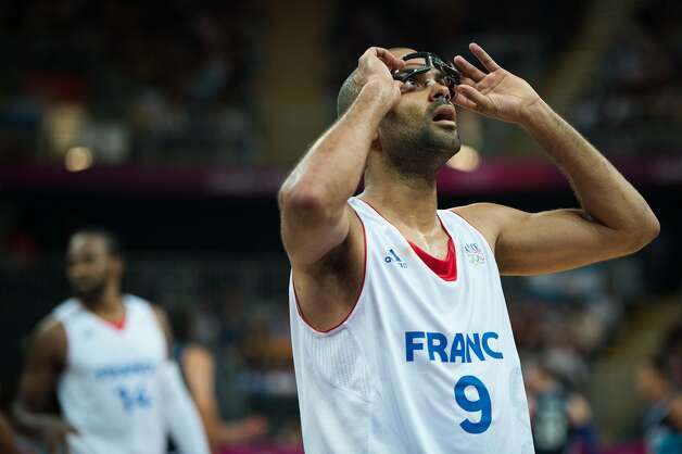 France's Tony Parker adjusts his glasses during  a men's preliminary round basketball game against Argentina at the 2012 London Olympics on Tuesday, July 31, 2012. (Smiley N. Pool / Houston Chronicle)