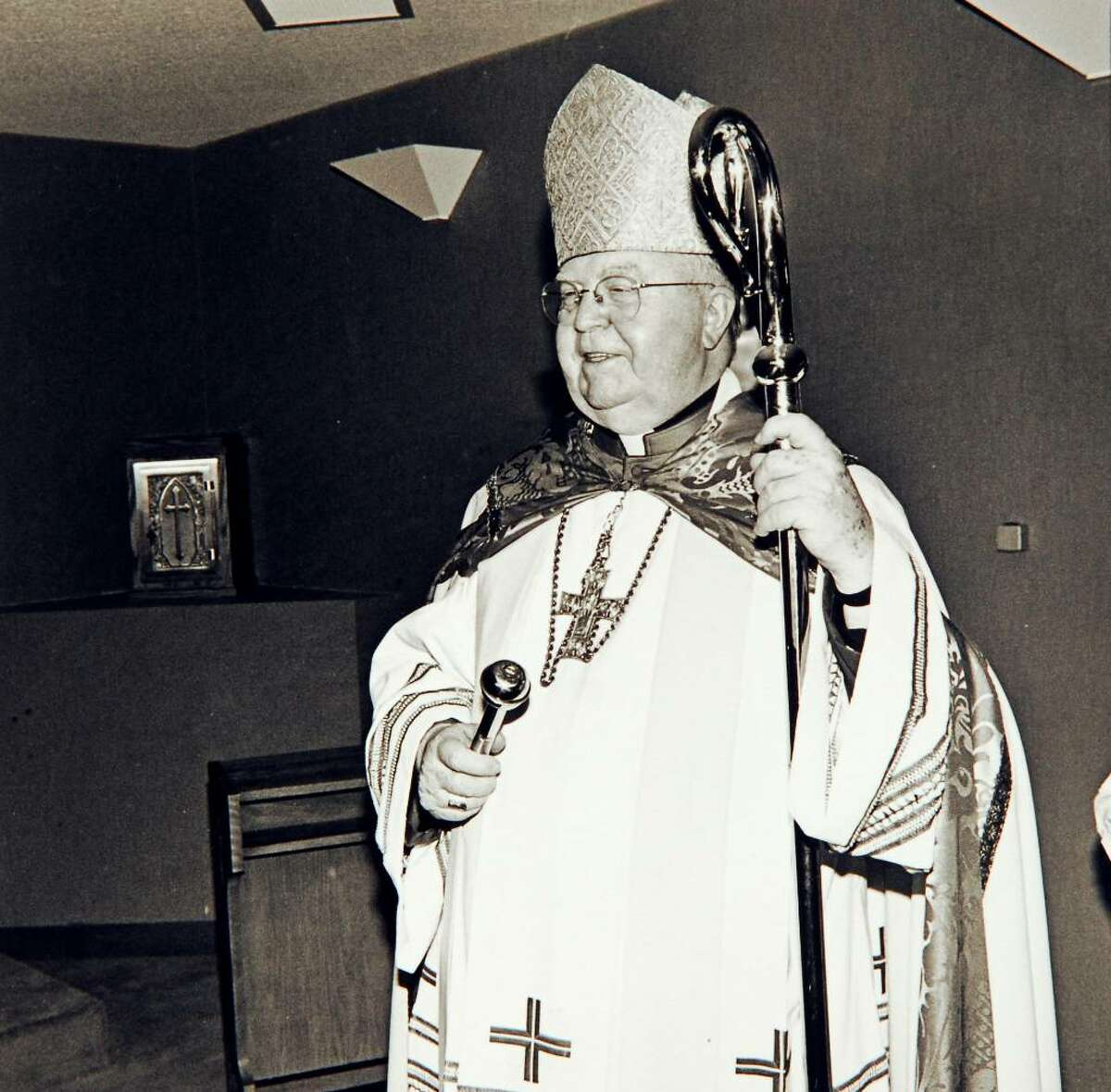 July 14th, 1988, Bishop Walter Curtis during the dedication of the St. Camillus Nursing Home on Elm Street in Stamford. Here Curtis blesses the chapel.