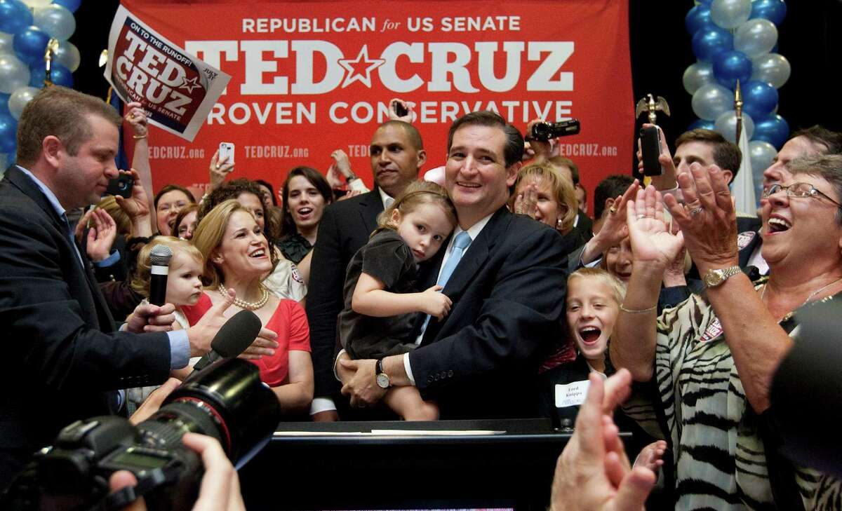 Holding his daughter Caroline, U.S. Senator candidate Ted Cruz and and his wife, Heidi, holding their daughter, Catherine, appear before a cheerful crowd after Cruz defeated Republican rival, Lt. Gov. David Dewhurst in a runoff election for the U.S. Senate seat vacated by Kay Bailey Hutchison Tuesday, July 31, 2012, in Houston. (AP Photo/Houston Chronicle, Johnny Hanson) MANDATORY CREDIT