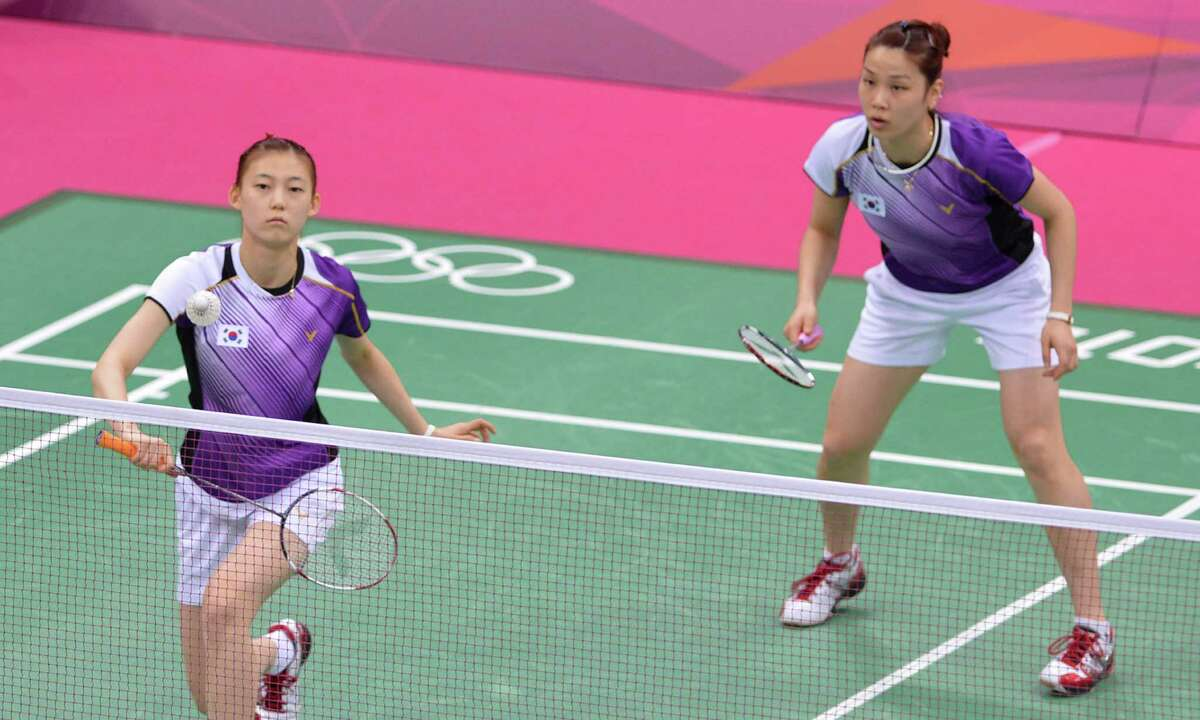 This picture taken on July 31, 2012 shows Kim Ha Na (L) and Jung Kyung Eun of South Korea playing a shot during their women's doubles badminton match against China's Wang Xiaoli and Yu Yang at the London 2012 Olympic Games in London on July 31, 2012. Eight players involved in a match-fixing scandal at the Olympic badminton tournament have been disqualified from the Games, a senior source with knowledge of the case told AFP on August 1, 2012. The eight players -- four from South Korea, two from Indonesia and two from China -- were disqualified following a disciplinary hearing of the Badminton World Federation, the source told AFP.AFP PHOTO / ADEK BERRYADEK BERRY/AFP/GettyImages