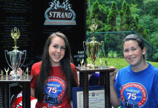 Michelle, 17, left, and Peyton Strand, 13, display their soapbox derby world championship trophies at their New Milford home. July 2012 Photo: Michael Duffy