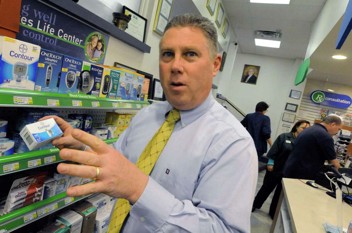 Archival shot of Assemblyman John McDonald working at Marra's Pharmacy. (Michael P. Farrell / Times Union archive). (Michael P. Farrell / Times Union archive)