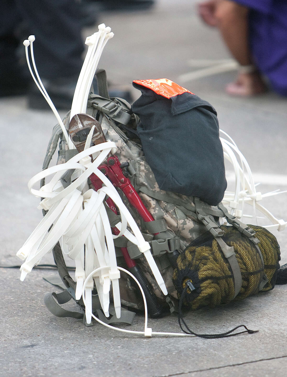 A bag with tools used to arrest protesters is seen at the intersection of Dallas and Smith Streets Wednesday, August 1, 2012, in Houston. Civil rights and labor activists are currently demonstrating civil disobedience and supporting janitors who are entering their fourth week of an unfair labor practices strike.