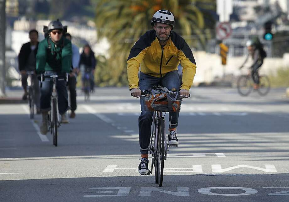 Bicycle commuting is a reliable, inexpensive and healthy way to get around. Photo: Paul Chinn, The Chronicle