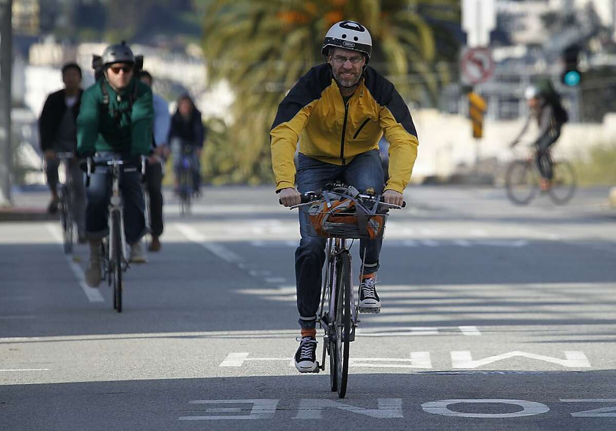 Bicyclists commute towards downtown on Market Street in San Francisco, Calif. on Friday, April 6, 2012. The San Francisco Bicycle Coalition distributed its Rules of the Road flyers to cyclists after a pedestrian was run over and killed by a two-wheeler last week.