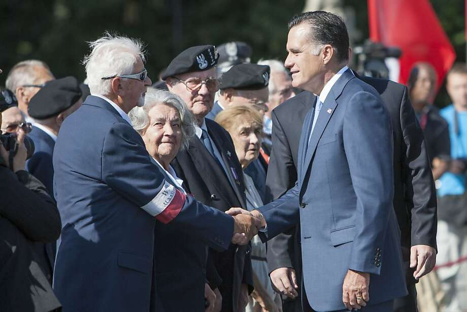 WARSAW, POLAND - JULY 31:  U.S. Republican presidential candidate, former Massachusetts Gov. Mitt Romney (R), speaks to veterans after he layed a wreath at the Tomb of the Unknown Soldier on July 31, 2012 in Warsaw, Poland. After visiting London, Israel, and the polish city of Gdansk, Romney visits the capital of Poland, Warsaw.  (Photo by Carsten Koall/Getty Images) Photo: Carsten Koall, Getty Images