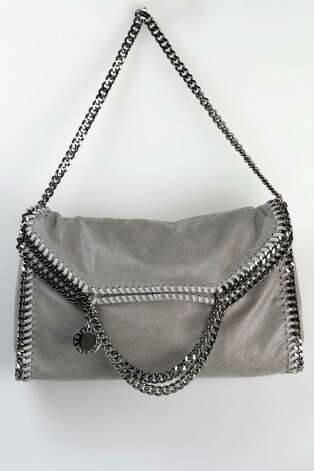 Stella McCartney gray hobo/clutch bag with chain strap and embellishment, $1,095, Saks Fifth Avenue Photo: Julysa Sosa, Staff / © 2012 San Antonio Express-News
