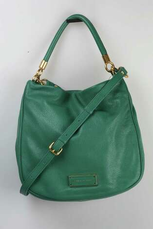 "Marc Jacobs ""Too Hot to Handle Hobo"" bag in teal, $438, Saks Fifth Avenue Photo: Julysa Sosa, Staff / © 2012 San Antonio Express-News"