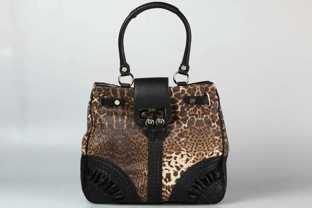"Marc Jacobs red cross-body ""Shiraz"" bag with bird embellishment, $438, Julian Gold Photo: Julysa Sosa, Staff / © 2012 San Antonio Express-News"