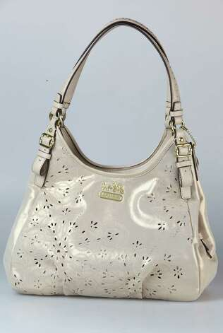 Coach neutral and gold shimmer lace cut leather bag, $498, Dillard's and Macy's Photo: Julysa Sosa, Staff / © 2012 San Antonio Express-News
