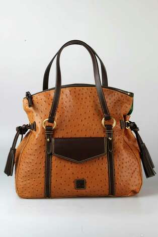 Dooney & Bourke tan and brown embossed tote with side tassles, $398, Dillard's Photo: Julysa Sosa, Staff / © 2012 San Antonio Express-News