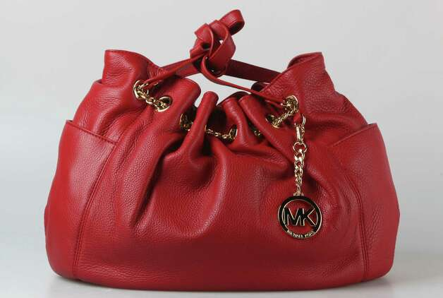 Michael Kors red hobo with gold chain, $298, Dillard's Photo: Julysa Sosa, Staff / © 2012 San Antonio Express-News