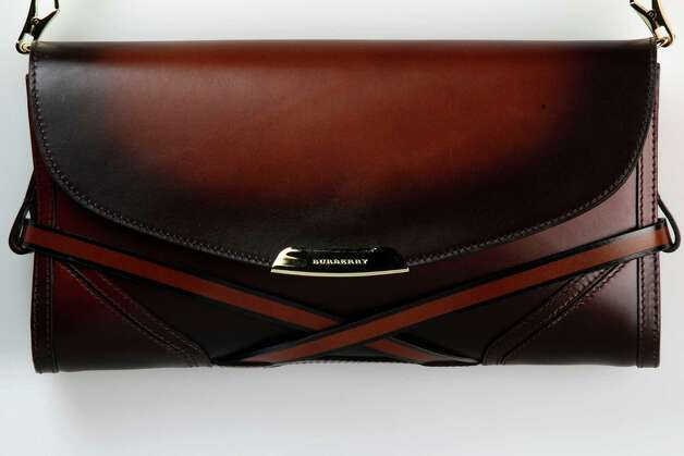 Burberry sprayed bridle leather clutch, $1,295, from SAKS Fifth Avenue Friday,  June 8, 2012. Part of the women's handbags that will transition from mid-summer into fall. Photo: Julysa Sosa, Staff / © 2012 San Antonio Express-News