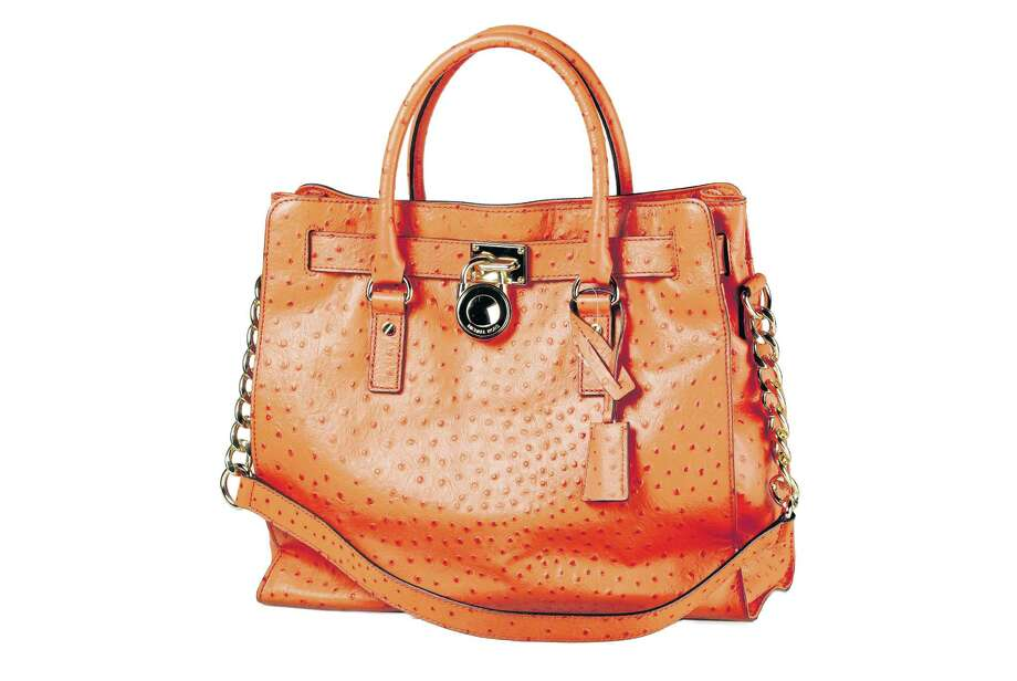 Michael Kors Tangerine leather ostrich embossed tote sells for $398, and is available at Dillard's at North Star Mall. Photo: Julysa Sosa, San Antonio Express-News / San Antonio Express-News