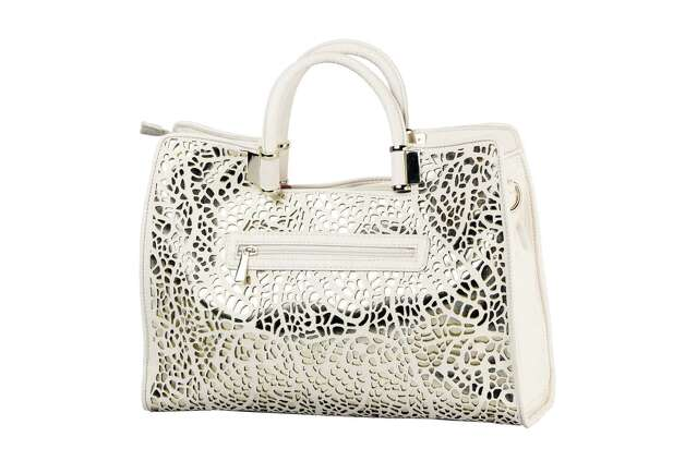 Ivanka Trump off white and gold metallic laser cut leather handbag, $175, Dillard's Photo: Julysa Sosa, Staff / San Antonio Express-News