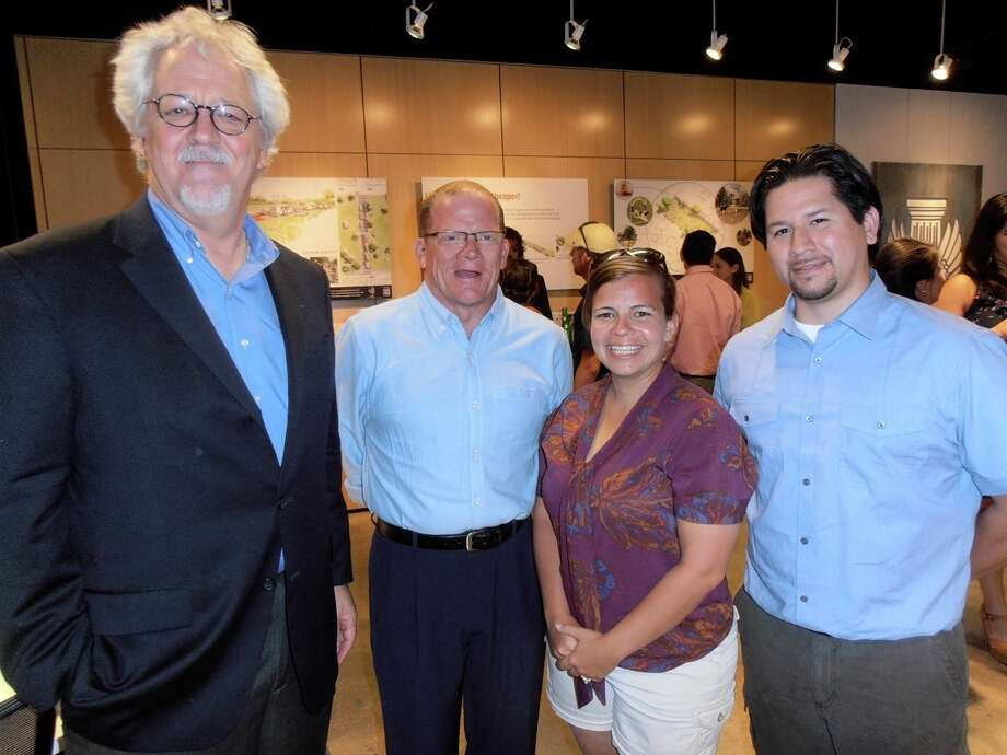 "AIA President Mike McGlone, from left, visits with three community developers of ""Faster, Quicker, Cheaper!"" ideas, Terence Peak, Meredith Ruiz and Andy Castillo, at a reception presenting the proposals at the Center for Architecture. Photo: Nancy Cook- Monroe, San Antonio Express-News"