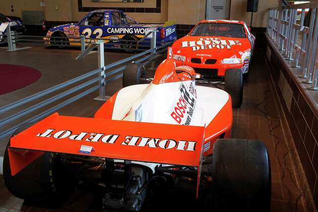 Both the Dallara Indy car and the Pontiac Tony Stewart used in scoring the Indianapolis 500 and the Coca Cola 600 are displayed at the Saratoga Automobile Museum in their current exhibit, NASCAR's History, Heroes and Technology, Monday July 16, 2012, in Saratoga Springs, N.Y.  (Dan Little/Special to the Times Union) Photo: Dan Little / Copyright: All Rights Reserved Brett Carlsen