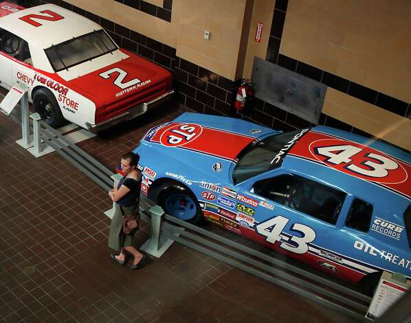 On display are cars driven by Bobby Allison and Richard Petty.  The vehicles are part of the ?Moonshine to Millionaires:  NASCAR History, Heroes and Technology? exhibit at Saratoga Auto Museum's which runs through Nov. 25 in Saratoga Springs, N.Y.  Photo taken Monday, July 16, 2012. (Dan Little/ Special to the Times Union) Photo: Dan Little / Copyright: All Rights Reserved Brett Carlsen