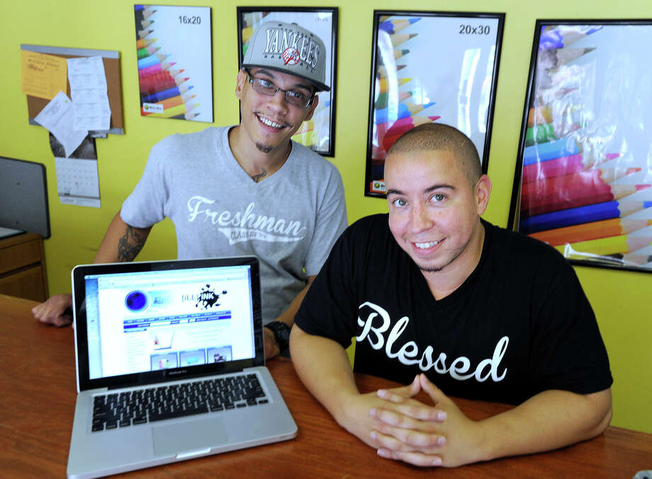 Rafael Diaz, left, and Josue Velez, both 30 and from Danbury, are partners in iLL iNK, a graphic and printing services business on Main Street in Danbury, Monday, July 30, 2012. Photo: Carol Kaliff