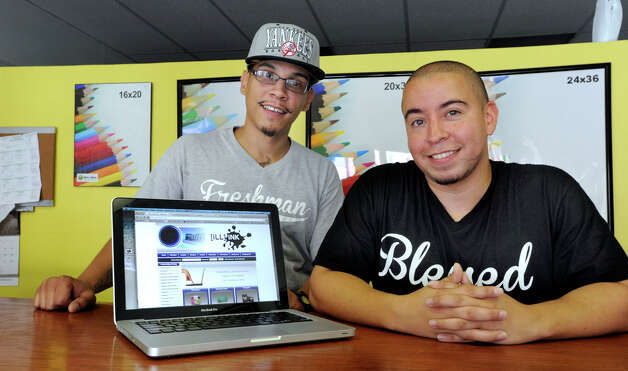 Rafael Diaz, left, and Josue Velez, both 30 and from Danbury, are partners in iLL iNK, a graphic and printing services business on Main Street in Danbury, Monday, July 30, 2012. Photo: Carol Kaliff / The News-Times