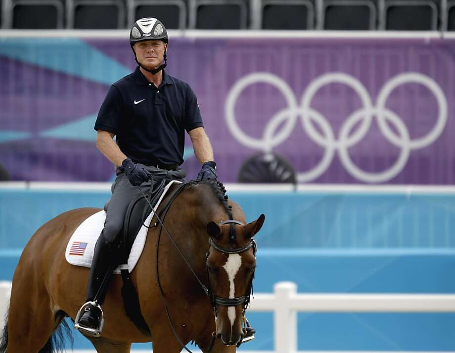 Jan Ebeling of the United States, rides his horse Rafalca during a training session for the equestrian dressage competition at the 2012 Summer Olympics, Wednesday, Aug. 1, 2012, in London. Rafalca is co-owned by Ann Romney, the wife of U.S. Republican presidential candidate Mitt Romney. (AP Photo/David Goldman) Photo: David Goldman, Associated Press