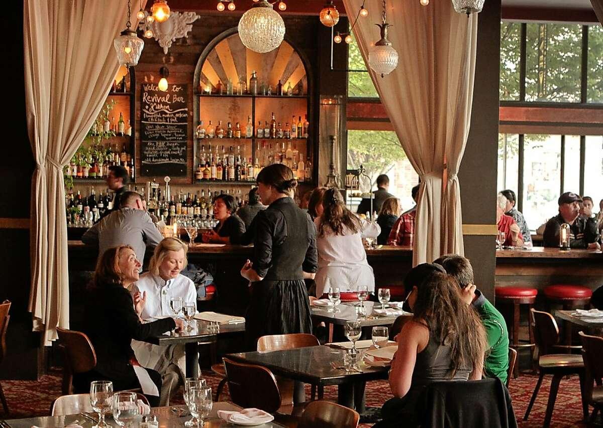 Diners enjoy dinner at Revival Bar & Restaurant in Berkeley, Calif., on Wednesday, July 25th, 2012.