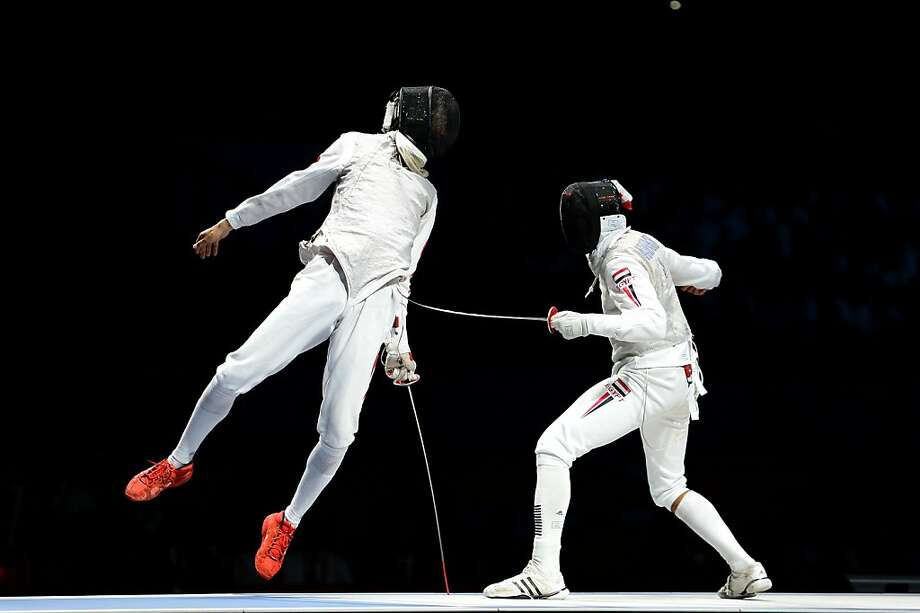 Nice touch (falsetto voice)! Alaaeldin Abouelkassem of Egypt sticks China's Sheng Lei in the nether regions during the men's foil gold medal bout . Photo: Lars Baron, Getty Images