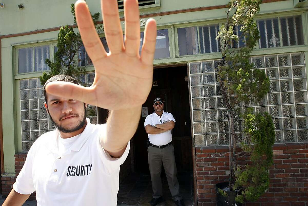 LOS ANGELES, CA - JULY 25: A security guard working for the Van Nuys Organics medical marijuana dispensary puts his hand in front of the camera as the photographer takes a picture of the dispensary storefront from the public sidewalk on July 25, 2012 in the Eagle Rock section of Los Angeles, California. The Los Angeles City Council has unanimously voted to ban storefront medical marijuana dispensaries and to order them to close or face legal action. The council also voted to instruct staff to draw up a separate ordinance for consideration in about three months that might allow dispensaries that existed before a 2007 moratorium on new dispensaries to continue to operate. It is estimated that Los Angeles has about one thousand such facilities. The ban does not prevent patients or cooperatives of two or three people to grow their own in small amounts. Voters in California legalized medical cannabis use in 1996, clashing with federal drug laws. The state Supreme Court is expected to consider ruling on whether cities can regulate and ban dispensaries. (Photo by David McNew/Getty Images)